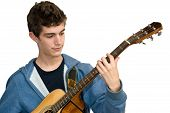 stock photo of acoustic guitar  - Teenager playing acoustic guitar on white background - JPG