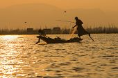 Постер, плакат: Fishermen In Inle Lakes Sunset Myanmar
