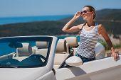 Постер, плакат: Beautiful woman in a white convertible car
