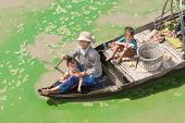 Boatpeople at Tonle Sap Lake in Cambodia