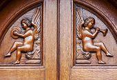 Angels On Wooden Door