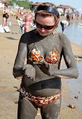 Applying Mud From The Dead Sea
