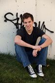 Smiling Teen Guy And Graffitti