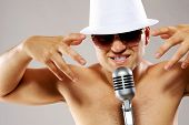 foto of gangster necklace  - Picture of a glamorous man sing a song - JPG