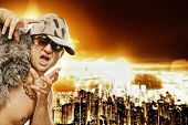 stock photo of gangster necklace  - Stylish glamorous rapper in front of modern night city - JPG