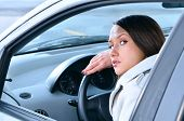 Beautiful Sensual Woman Put Her Head On Steering Wheel And Looking Back At Camera