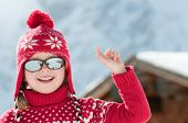 foto of winter sport  - Happy little girl in winter resort portrait - JPG