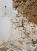 Old Ruined Stone Staircase In The Streets Of The Greek Islands - A Typical And Characteristic Of Gre