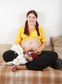 Pregnant Woman Knitting With Knitting-needle