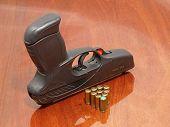 Black Pistol And Gas Cartridges.