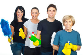 picture of house cleaning  - Cheerful team of four people holding cleaning products isolated on white background - JPG