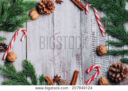 poster of Christmas Composition Background. Cinnamon Sticks, Pine Cones, Fir Branches On Wooden Background. Fl