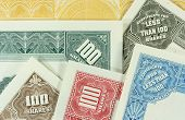 stock photo of debenture  - Colorful authentic old share certificates of American corporations - JPG