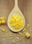 Grated Cheese On Wooden Spoon