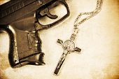 image of mobsters  - Crucifix and Hand gun in partial view of frame with Grunge image processing - JPG