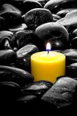 Meditation Candle Over River Stones