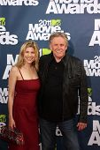 LOS ANGELES - JUN 5:  Steffanie Sampson; Gary Busey arriving at the the 2011 MTV Movie Awards at Gib