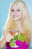Cheerful blonde holds in hand glass and  mint