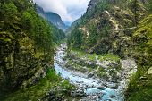 Mountain Canyon Valley. Beautiful river landscape and mountain forest in Nepal. Trekking route to Ev poster