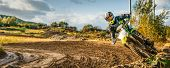 Extreme Motocross Mx Rider Riding On Dirt Track poster