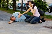 stock photo of dizziness  - A man has a dizzy spell or a heart attack - JPG