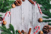 Christmas Composition Background. Cinnamon Sticks, Pine Cones, Fir Branches On Wooden Background. Fl poster