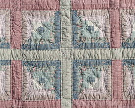 pic of scrappy  - Homemade colorful padded pattern patchwork folksy multicolored quilt - JPG