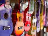 Multi-colored Guitars. Little Guitars Of Different Colors. The Picture Was Taken On The Open Apertur poster