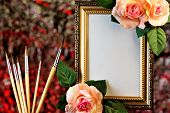 Frame Of Rose Flowers On A Romantic Festive Background Of Bokeh Lights And Artists Brush. The Paint poster