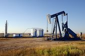 stock photo of oil well  - oil well and storage tanks in the texas panhandle - JPG
