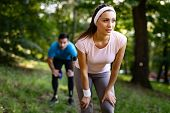 Exhausted Fit Couple Runners After Fitness Running Workout Outdoors poster