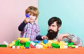 Building Home With Constructor. Little Boy With Bearded Man Dad Playing Together. Happy Family. Leis poster