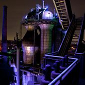 picture of blast-furnace  - steel industry blast furnace factory or plant abandoned old vintage and historical industrial architecture at night with colored lights Landschaftspark Duisburg - JPG