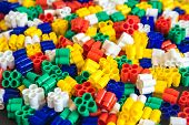 Multicolored Plastic Building Blocks Of The Designer. Background Of Plastic Colored Details Building poster