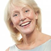 portrait of attractive  caucasian smiling mature woman blond isolated on white studio shot