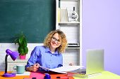 Portrait Of Student In University. Learning And Education Concept. Female Student Studying In Univer poster