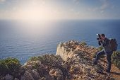 Tourist Standing On The Edge Of A Cliff And Photographing The Stunning Cliffs In Shipwreck Cove In S poster