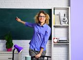 Beautiful Teacher In Classroom. Female Student Studying In University. Young Female Teacher. Young T poster