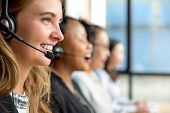 Friendly Beautiful Caucasian Woman Telemarketing Customer Service Agent Working In Call Center With  poster