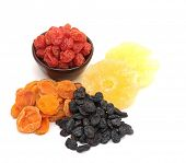 dried fruits - apricots, cherries, pineapple, sultanas on a white background