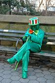 Green Woman Resting on a Bench