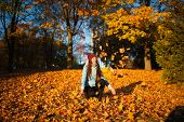 Happiness Carefree Leisure Concept. Redhaired Long Hair Woman Relaxing In Autumn Park Throwing Leave poster