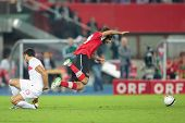 VIENNA,  AUSTRIA - AUGUST 15 Veli Kavlak (#19 Austria) and Mehmet Topal (#15 Turkey) fight for the b