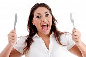 Portrait Of Shouting Woman With Fork And Knife