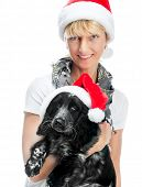 pretty young woman and dog in santa hat at Christmas over White background