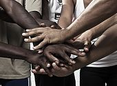 Closeup portrait of group with mixed race people with hands together