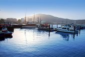 Los Cristianos harbor port sailboat sunrise in Adeje coast Arona Tenerife