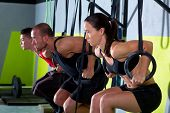 stock photo of dipping  - dip ring group workout at gym dipping in a row exercise - JPG