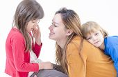 stock photo of love hurts  - A mother consoling her litlte daughter on white - JPG