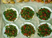 stock photo of nu  - Tiny prik ki nu chillies for sale in a market - JPG
